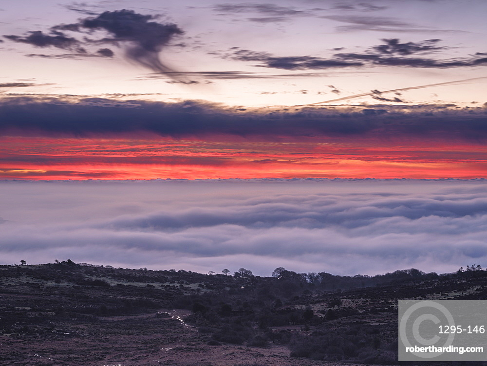 Dawn colours above mist viewed from Saddle Tor, Dartmoor National Park, Bovey Tracey, Devon UK