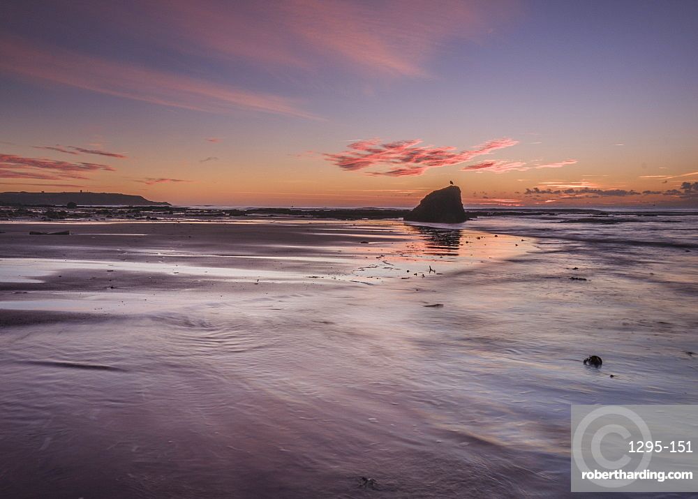 Vivid dawn cloud formation and wet sand, Sandy Bay, Orcombe Point, Exmouth, Devon, UK