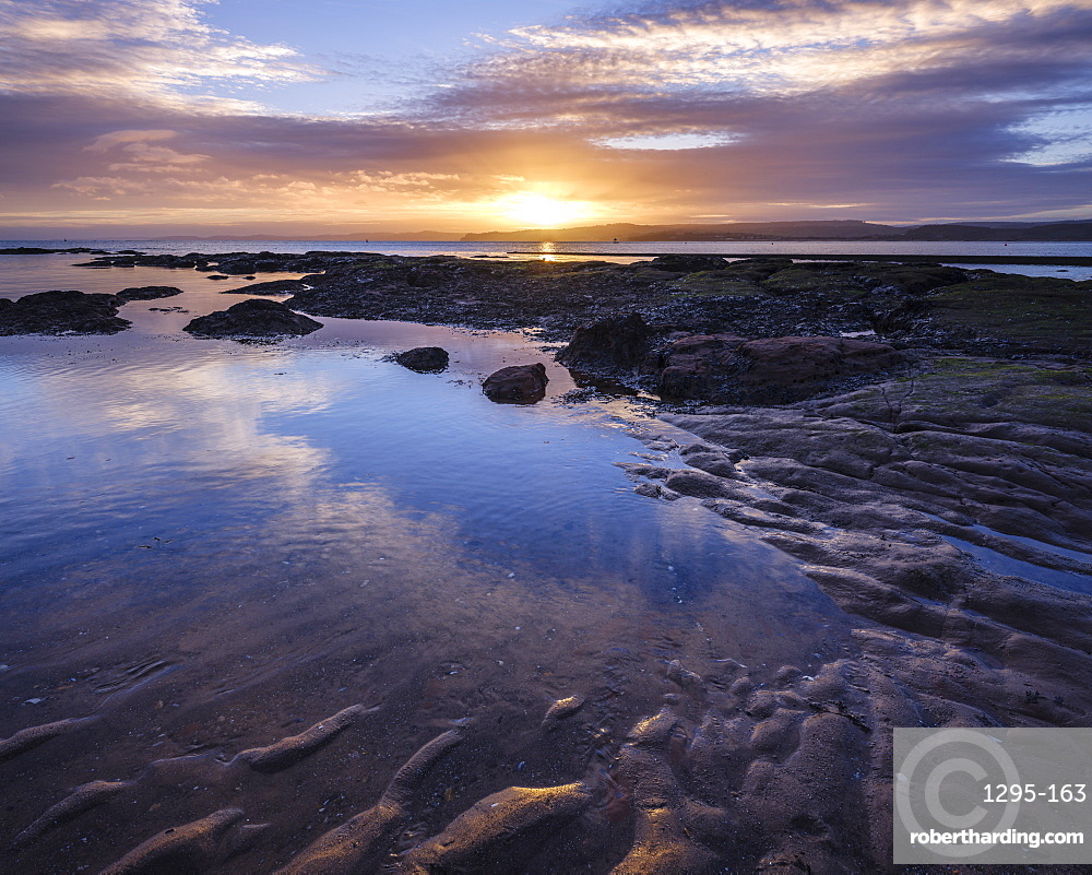 Winter sunset viewed from Maer Rocks, near Orcombe Point, Exmouth, Devon, UK