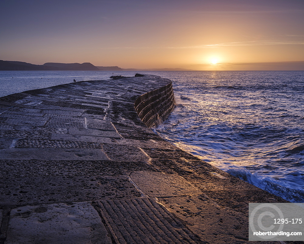 The harbour wall known as The Cobb enjoys a great deal of popularity and looks especially good in the light of dawn