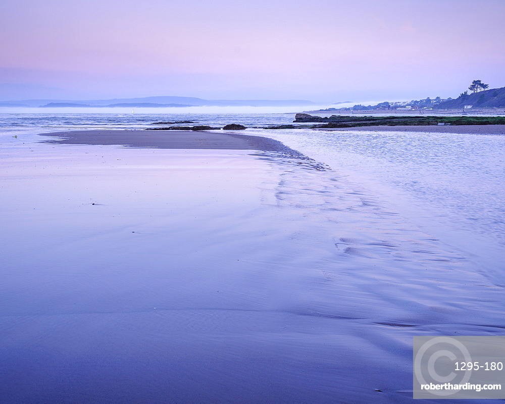 Twilight with mist coming out of River Exe, Orcombe Point, Exmouth, Devon, UK.