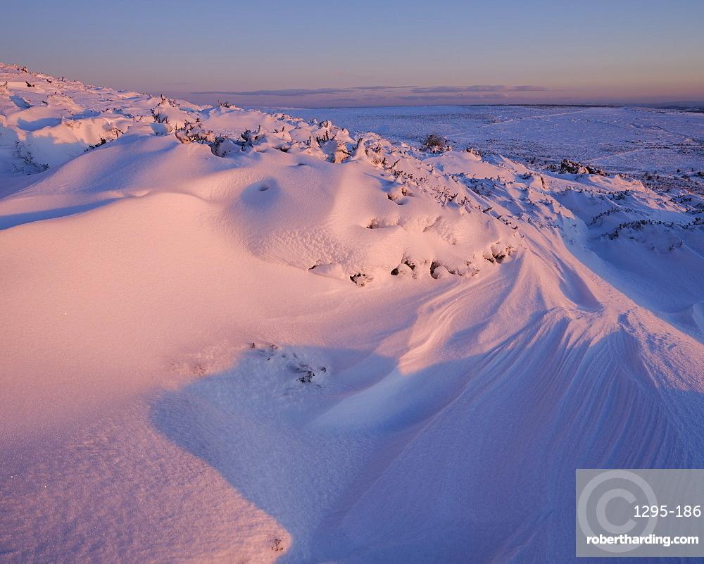 Bank of snow in early sunlight - Haytor, Bovey Tracey, Devon UK