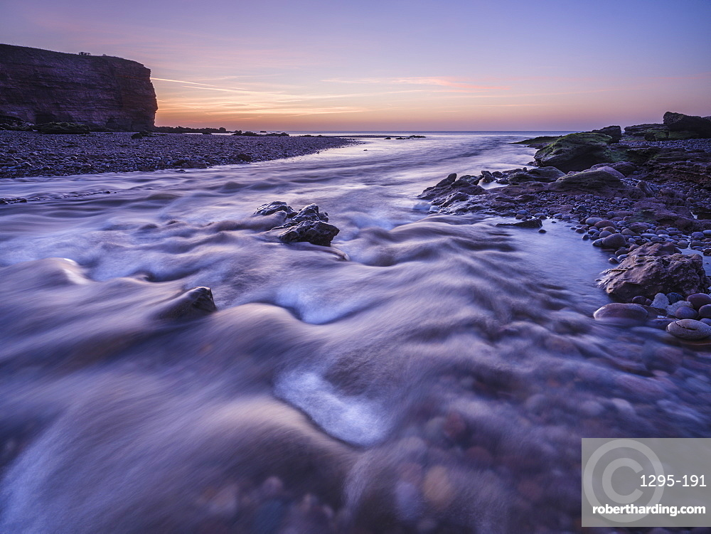 Twilight at mouth of River Otter at Budliegh Salterton, Devon, UK