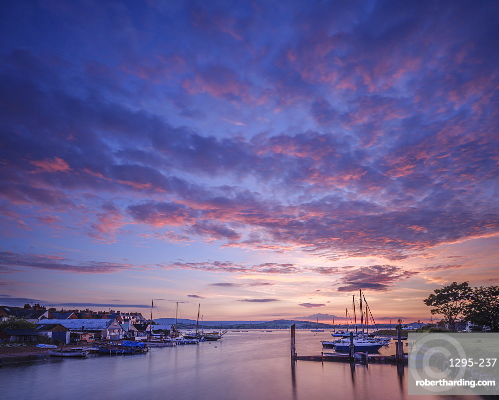 Sunset with boats on the Exe shoreline at the back of Camperdown Terrace, Exmouth, Devon, UK