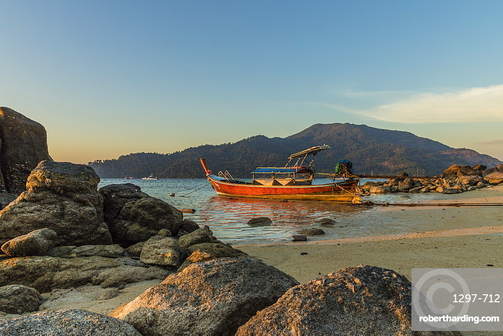 A long tail boat at dusk in Ko Lipe, Tarutao National Marine Park, Thailand, Southeast Asia, Asia