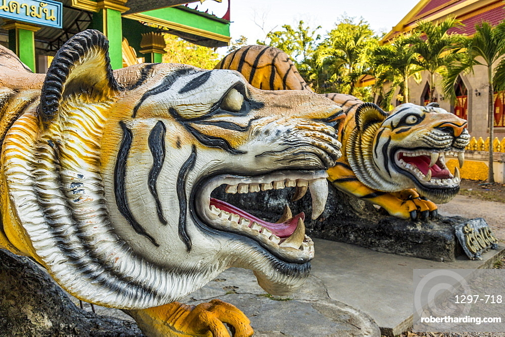 Tiger statues at the Tiger cave temple in Krabi, Thailand, Southeast Asia, Asia.