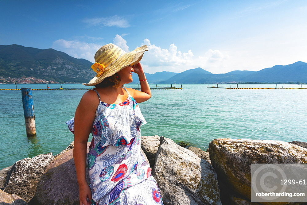 Woman admiring Lake Iseo, Clusane d'Iseo, Brescia province, Lombardy, Italy, Europe