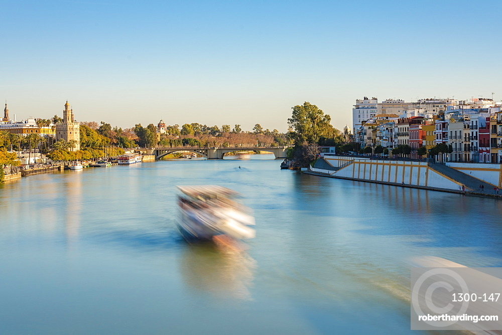 Long exposure of Betis Street in Triana and Guadalquivir River and the torre del oro on the left bank later afternoon