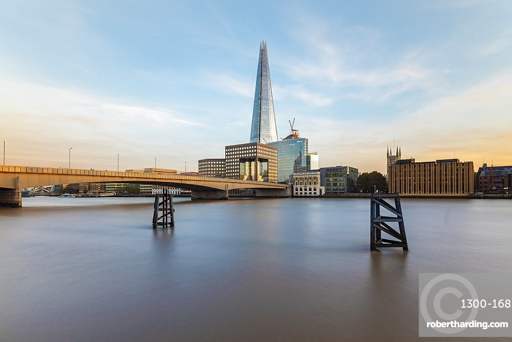 Long exposure with the London Bridge and the Shard on the background by sunset