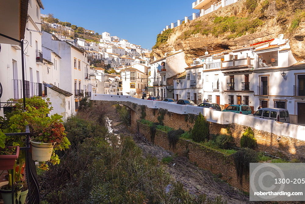 Setenil de las Bodegas in the province of Cadiz, with its white historic buildings and the houses under the rock mountain