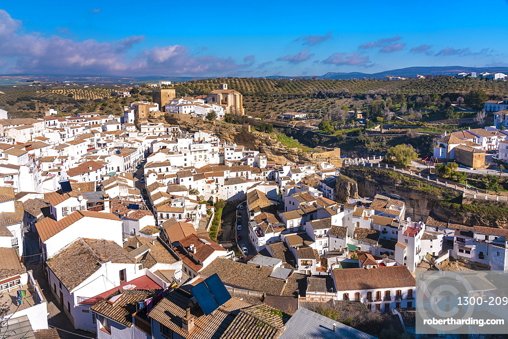 Overview of The Setenil de las Bodegas, with its white historic buildings and the houses under the rock mountain