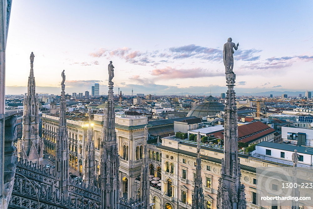 View of the statues on the Cathedral of Milan and the skyline of Milan seen on the background