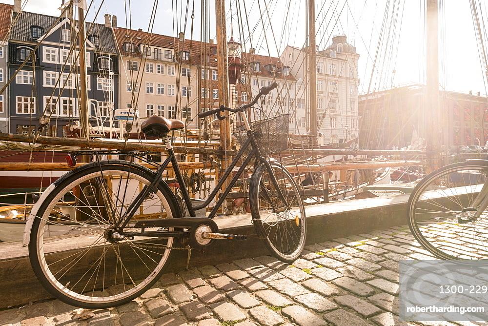 A bike parked on Nyhavn, the historic harbour, Copenhagen, Denmark, Europe