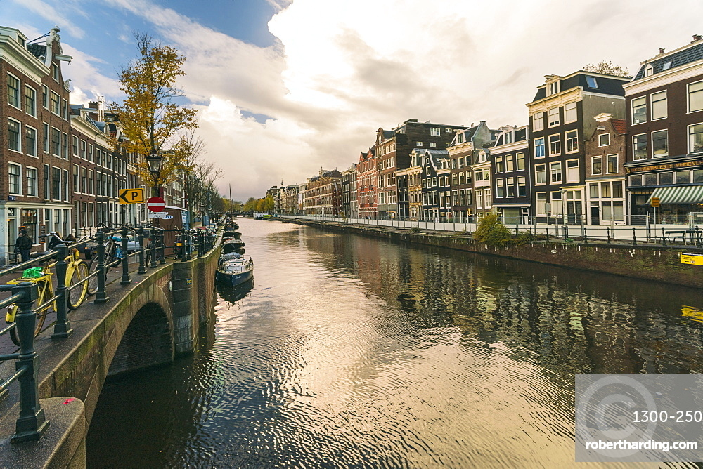 Canal at the historic center of Amsterdam close to the red light district in Autumn