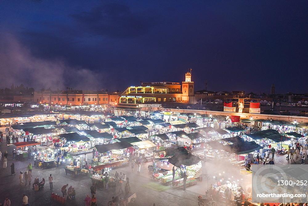 Jemaa el-Fnaa at sunset, bustling coartyard and market square