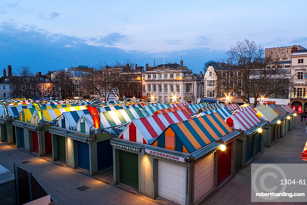 Looking out over the market towards the famous castle at dusk, Norwich, Norfolk, England, United Kingdom, Europe