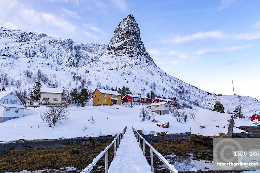 Pointed mountain of Reine with footbridge in winter, Reine, Lofoten, Nordland, Arctic, Norway, Europe