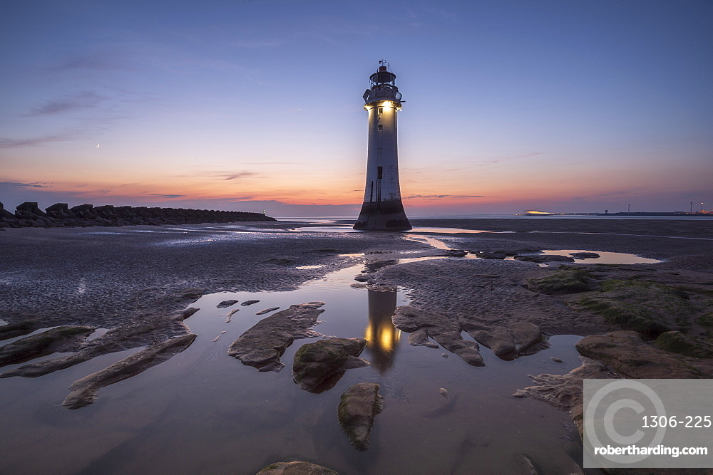 Perch Rock Lighthouse with evening moon, New Brighton, Cheshire, UK.
