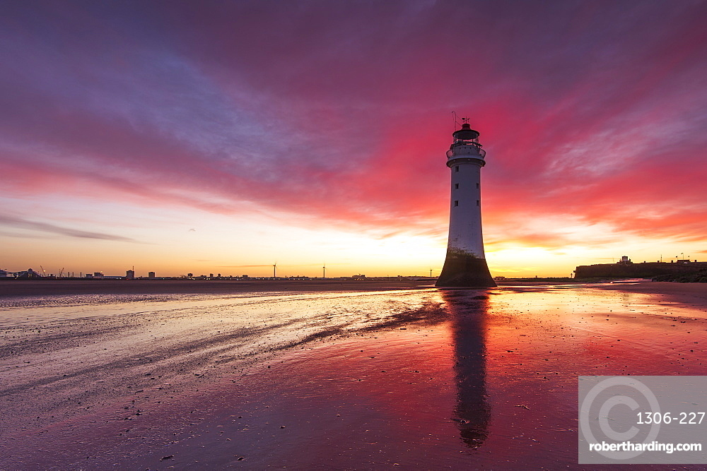 Incredible sunrise at Perch Rock Lighthouse, New Brighton, Cheshire, UK.