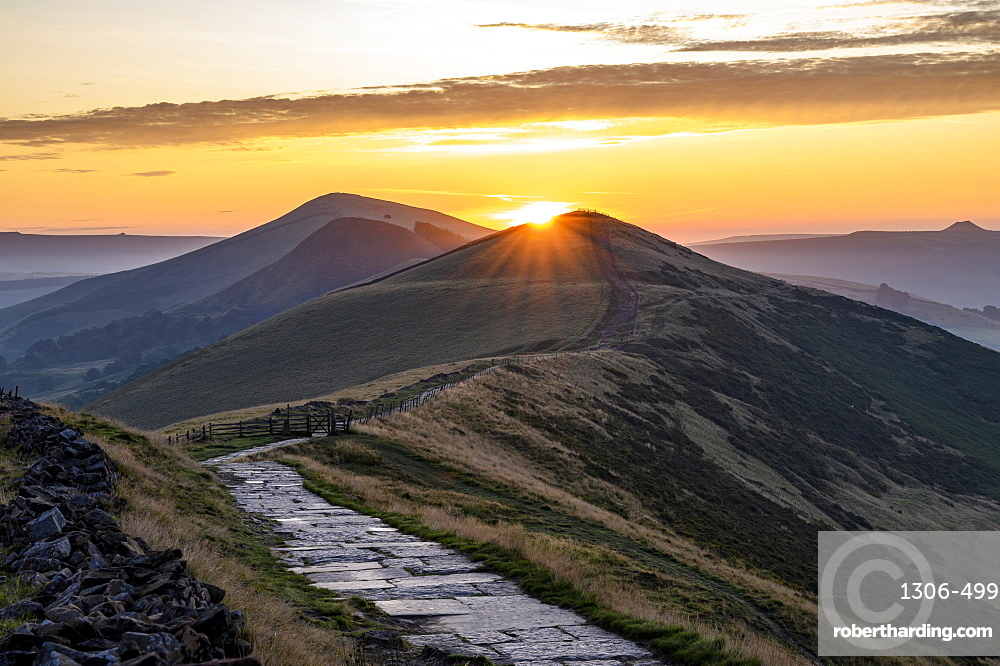 The sun rising above Lose Hill and Back Tor, The Peak District National Park, Derbyshire.