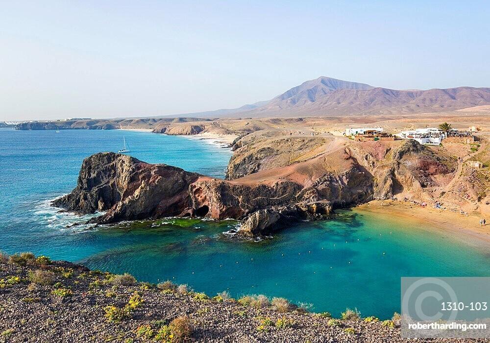View along coast from clifftop above Playa del Papagayo, Playa Blanca, Yaiza, Lanzarote, Las Palmas, Canary Islands, Spain