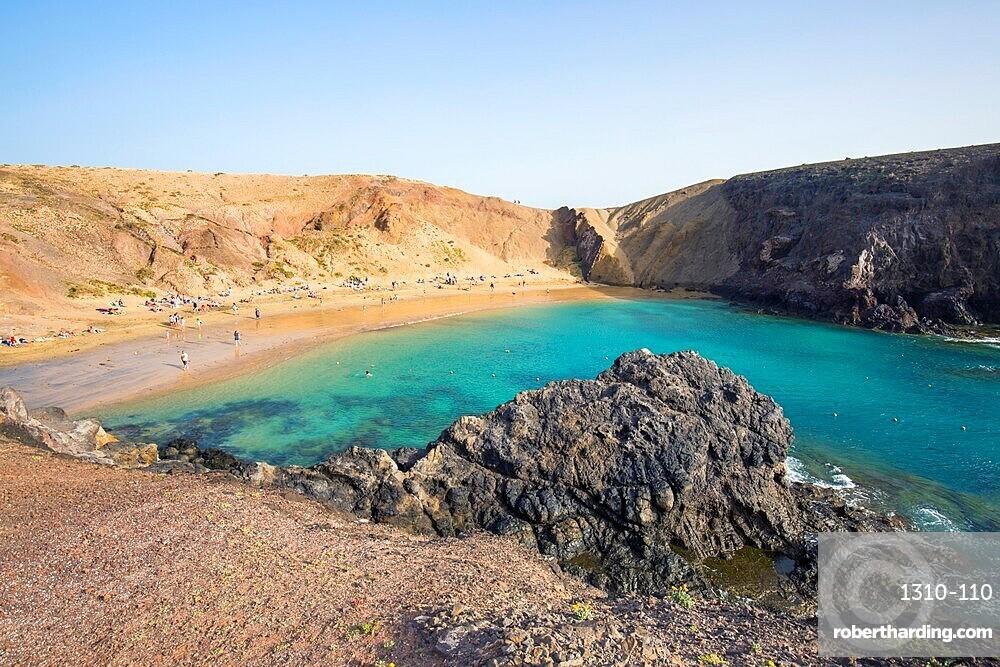 View over Playa del Papagayo from clifftop above the beach, Playa Blanca, Yaiza, Lanzarote, Las Palmas, Canary Islands, Spain