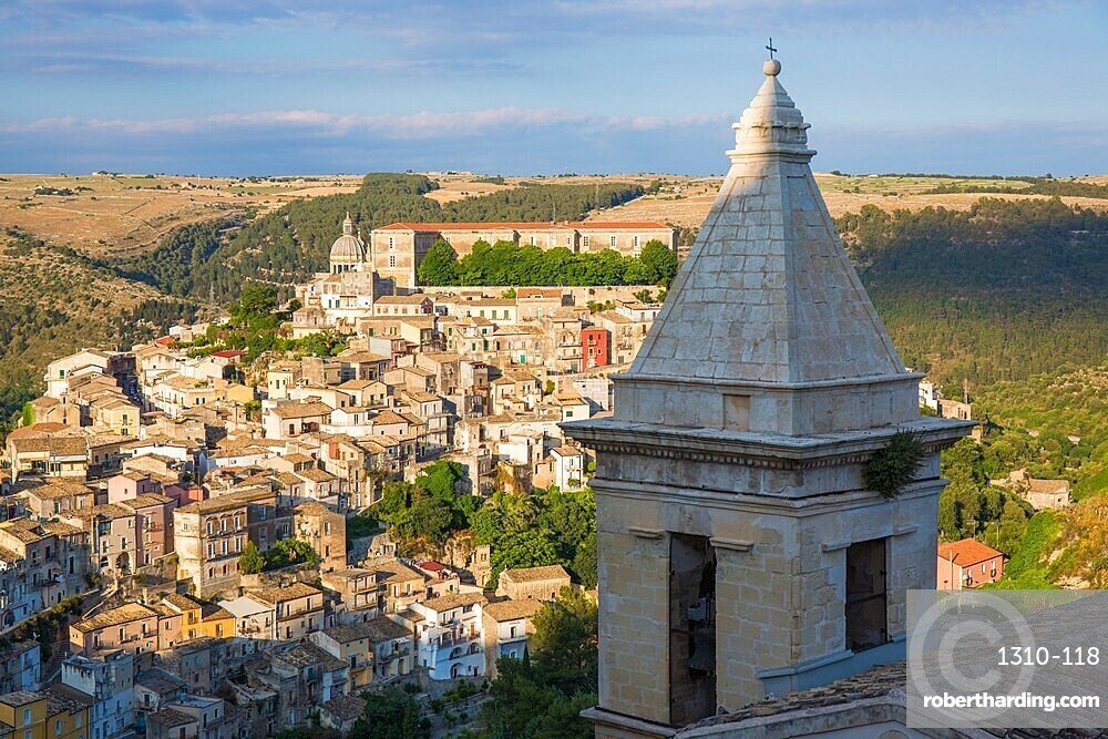 View over sunlit Ragusa Ibla, evening, bell-tower of the Church of Santa Maria delle Scale in foreground, Ragusa, Sicily, Italy