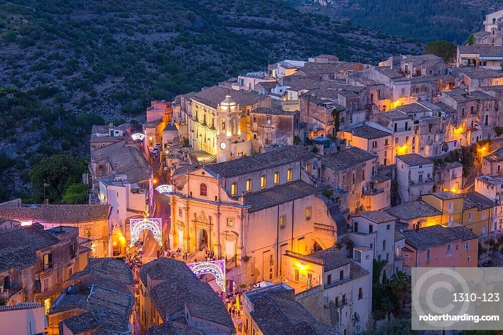 View over illuminated Ragusa Ibla, dusk, streets decorated to mark the Festival of San Giorgio, Ragusa, Sicily, Italy