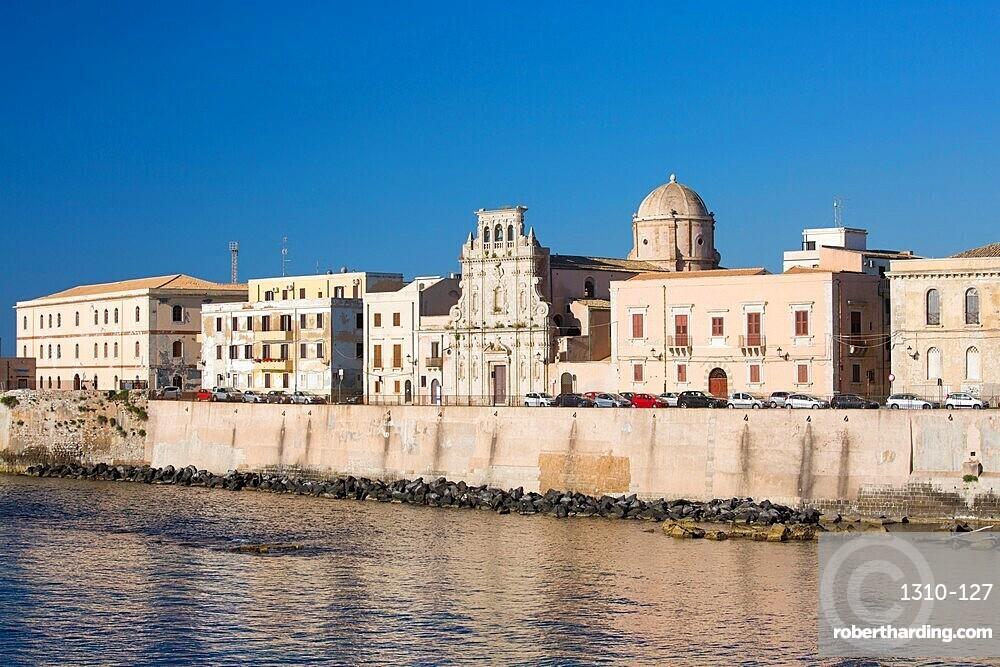 View across bay to the waterfront, early morning, Ortygia, aka Ortigia, Syracuse, Siracusa, Sicily, Italy