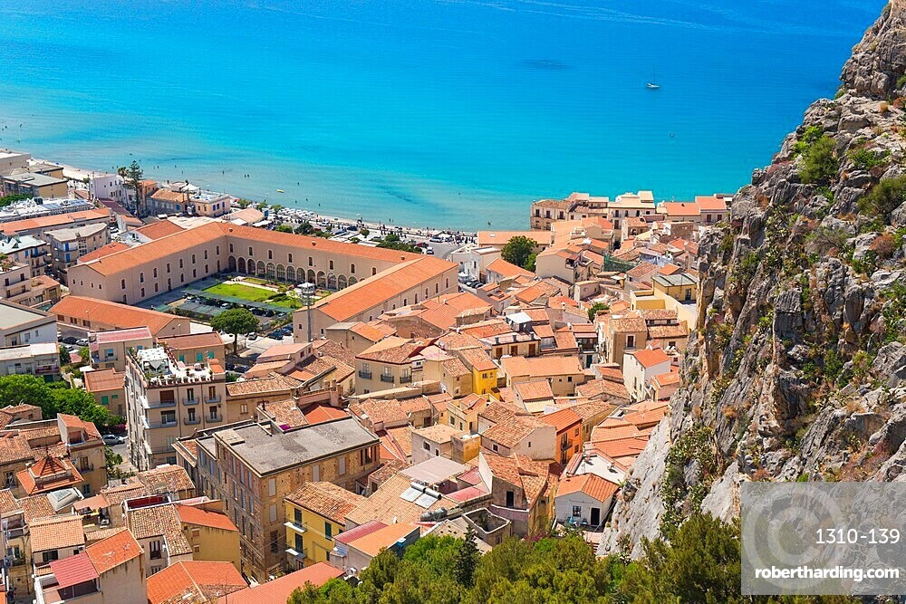 View from La Rocca over tiled rooftops to the calm turquoise waters of the Tyrrhenian Sea, Cefalu, Palermo, Sicily, Italy