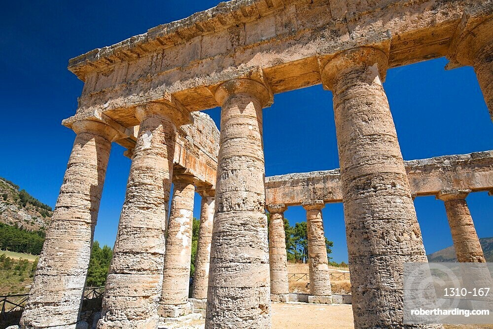 Low angle view of a section of the Doric temple at the ancient Greek city of Segesta, Calatafimi, Trapani, Sicily, Italy
