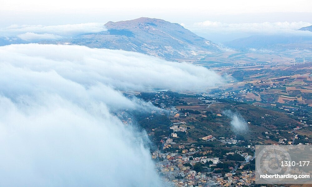 View over surrounding landscape from the city walls, clouds drifting across valley, Erice, Trapani, Sicily, Italy