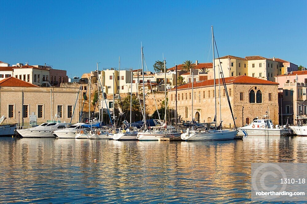 View across the Old Harbour, early morning, quayside buildings reflected in water, Hania (Chania), Crete, Greek Islands, Greece, Europe