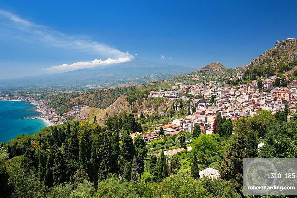 View over the town and coast from the Greek Theatre, Mount Etna in background, Taormina, Messina, Sicily, Italy