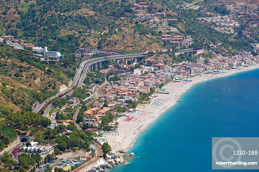 View from the Greek Theatre to the Ionian Sea beach resort of Mazzeo, Taormina, Messina, Sicily, Italy
