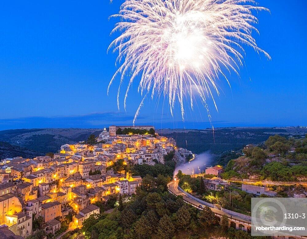 View over Ragusa Ibla, dusk, fireworks marking the Festival of San Giorgio, Ragusa, UNESCO World Heritage Site, Ragusa Province, Sicily, Italy, Europe