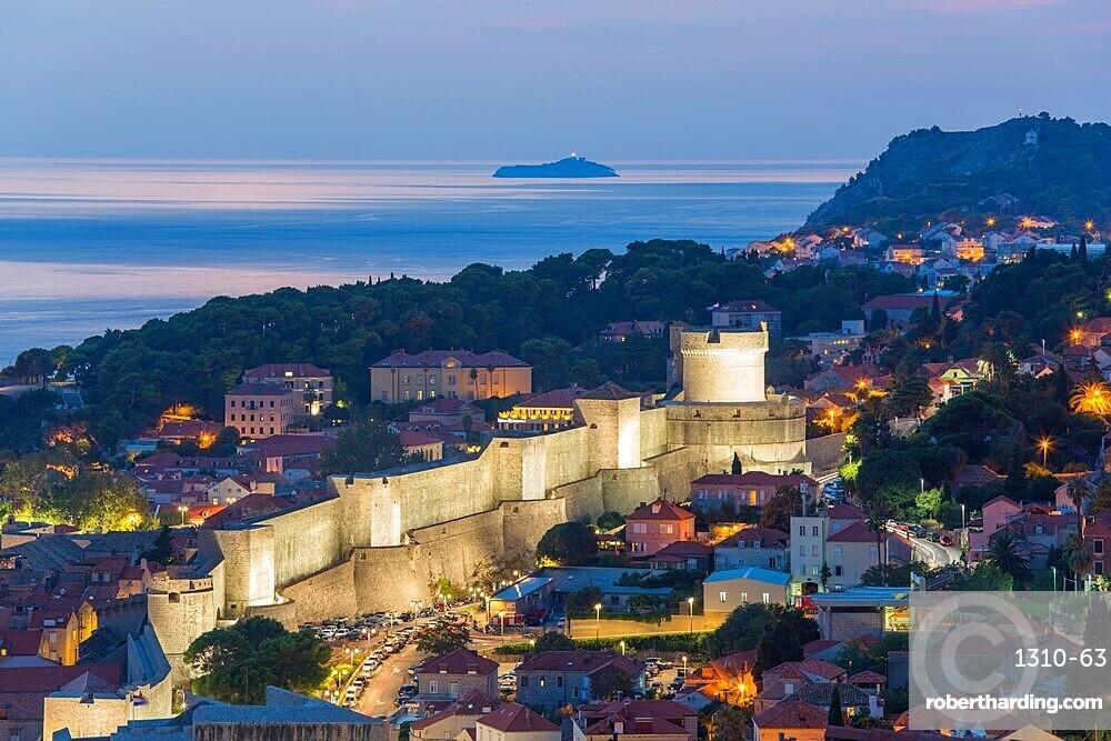 View over the illuminated city walls from above, dusk, the Adriatic Sea beyond, Dubrovnik, UNESCO World Heritage Site, Dubrovnik-Neretva, Dalmatia, Croatia, Europe