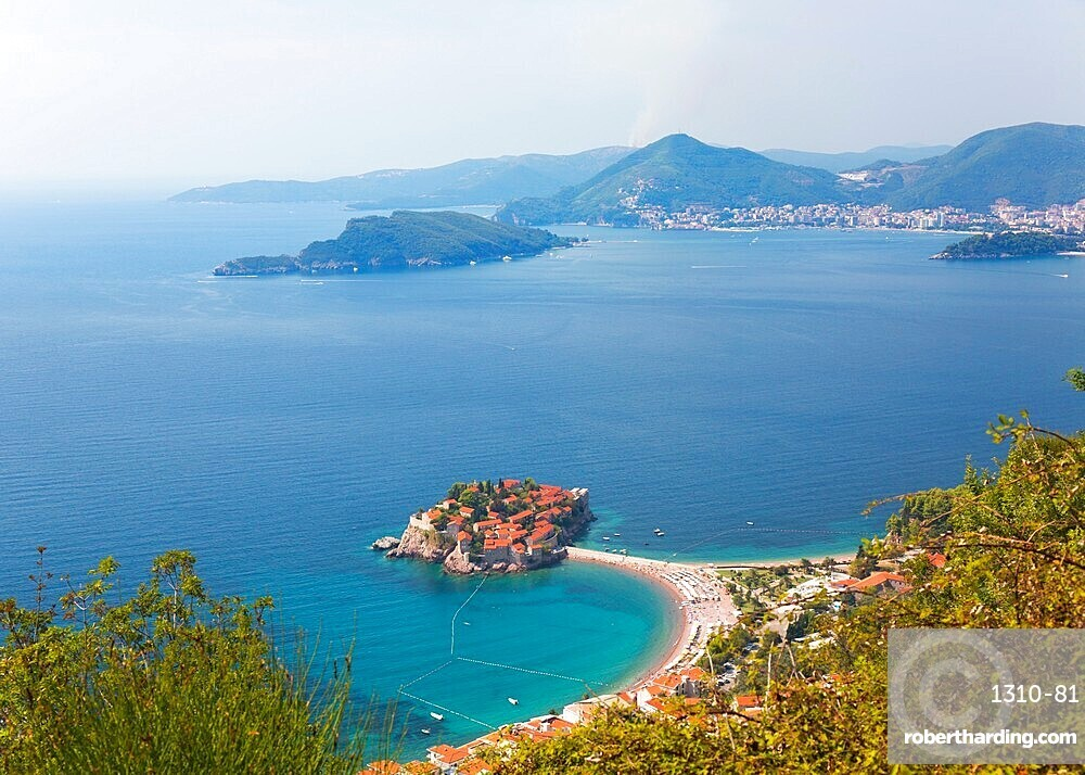 High angle view from hillside over Budva Bay and the exclusive island resort of Sveti Stefan, Budva, Montenegro, Europe
