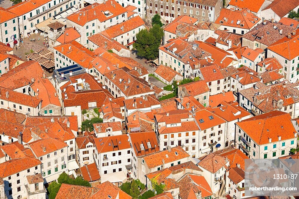 View over the tiled rooftops of the Old Town, Stari Grad, from the town walls, Kotor, Montenegro, Europe