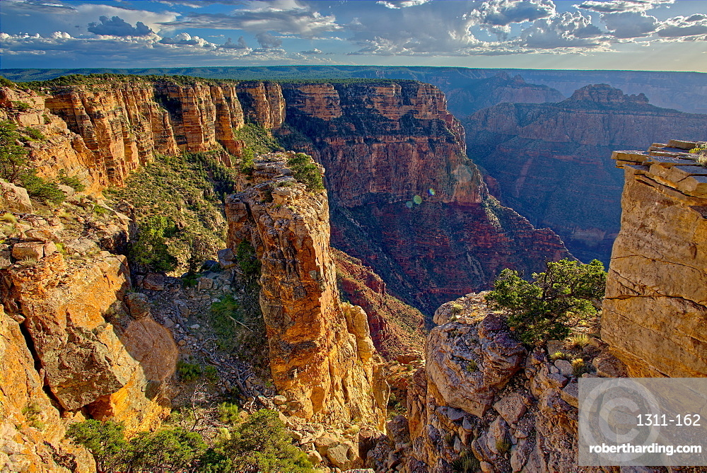 Pillars of rock standing just away from the cliff of the Grand Canyon south of Zuni Point with Moran Point in the distance, Grand Canyon National Park, UNESCO World Heritage Site, Arizona, United States of America, North America