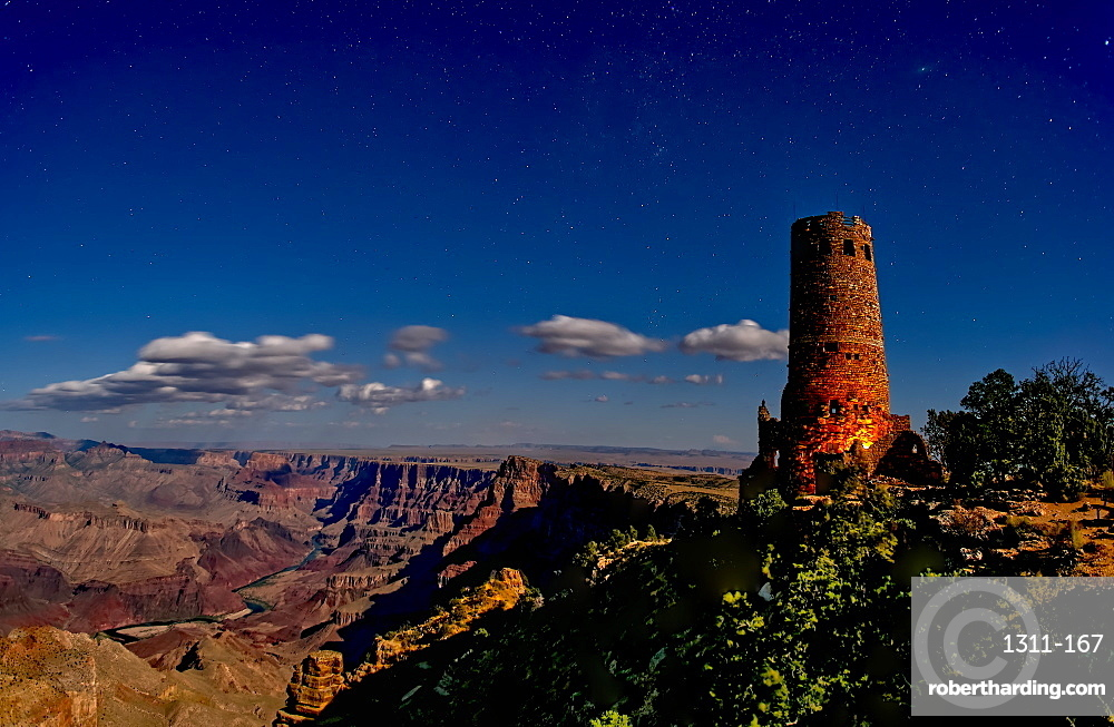 Watch Tower on south rim of Grand Canyon illuminated by moonlight.