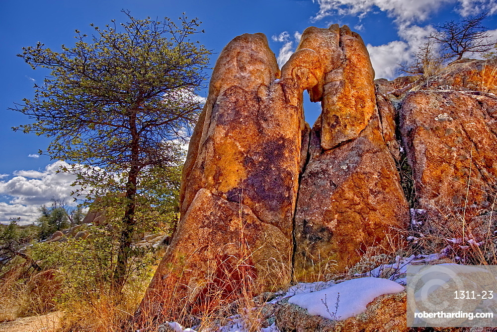 A granite rock formation along the Hole in the Wall Trail in Constellation Park in Prescott giving the trail its name, Arizona, United States of America, North America