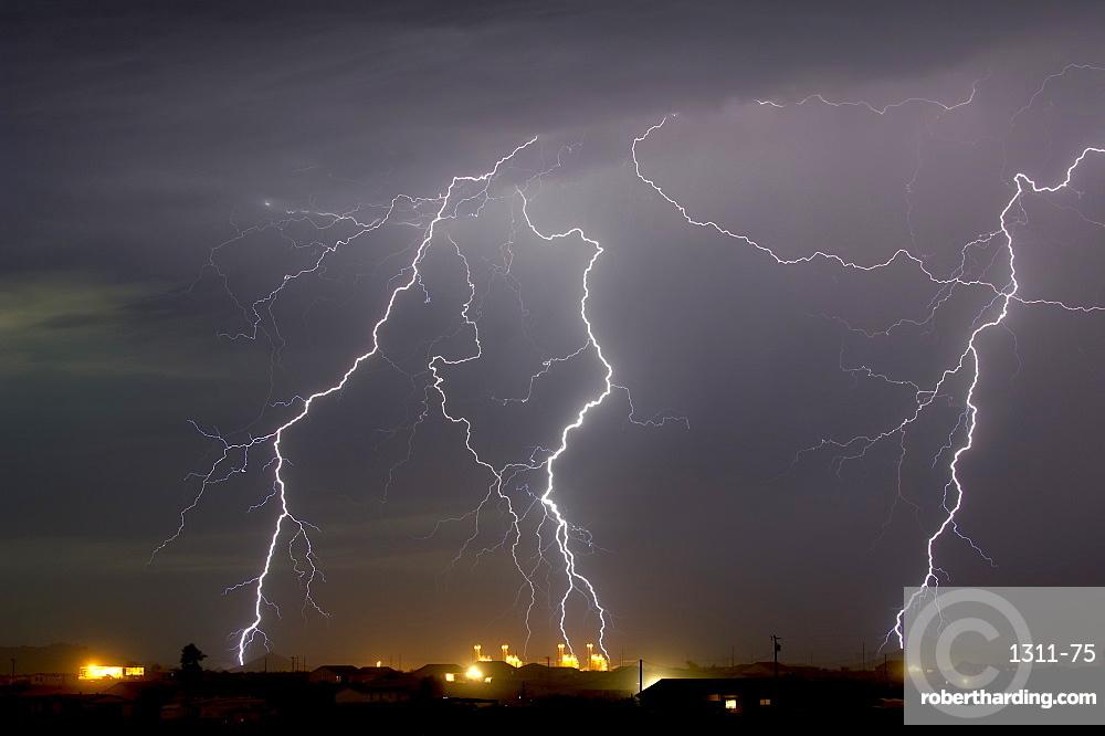 Multiple lightning bolts striking a power plant in Arlington during the 2016 monsoon season, Arizona, United States of America, North America