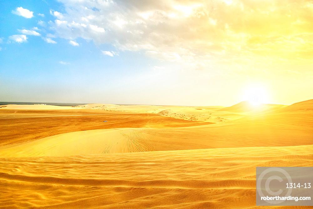 Desert landscape sand dunes at sunset sky near Qatar and Saudi Arabia.Khor Al Udeid, Persian Gulf, Middle East adventure concept
