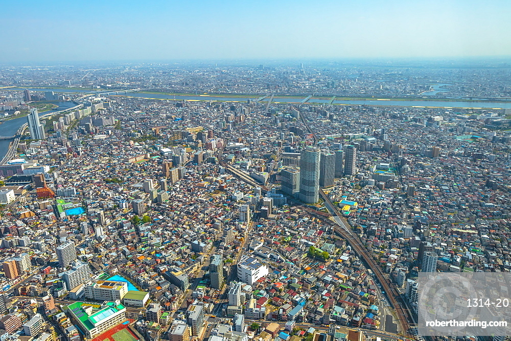 Aerial view of Tokyo city skyline with Asahi Beer Hall, Asahi Flame o Golden Turd, Sumida River Bridges and Asakusa area. Daytime. Tokyo, Japan.