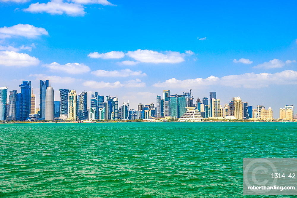 Banner panorama of Doha cityscape. West Bay skyline in Doha Bay. Qatar, Middle East, Arabian Peninsula in Persian Gulf. Copy space. Touquoise sea.