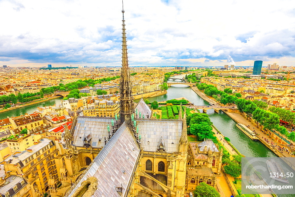 Detail of the spire of Notre Dame cathedral with statues, in Paris city capital of France. From top of the gothic church Our Lady of Paris, aerial view on Paris skyline.