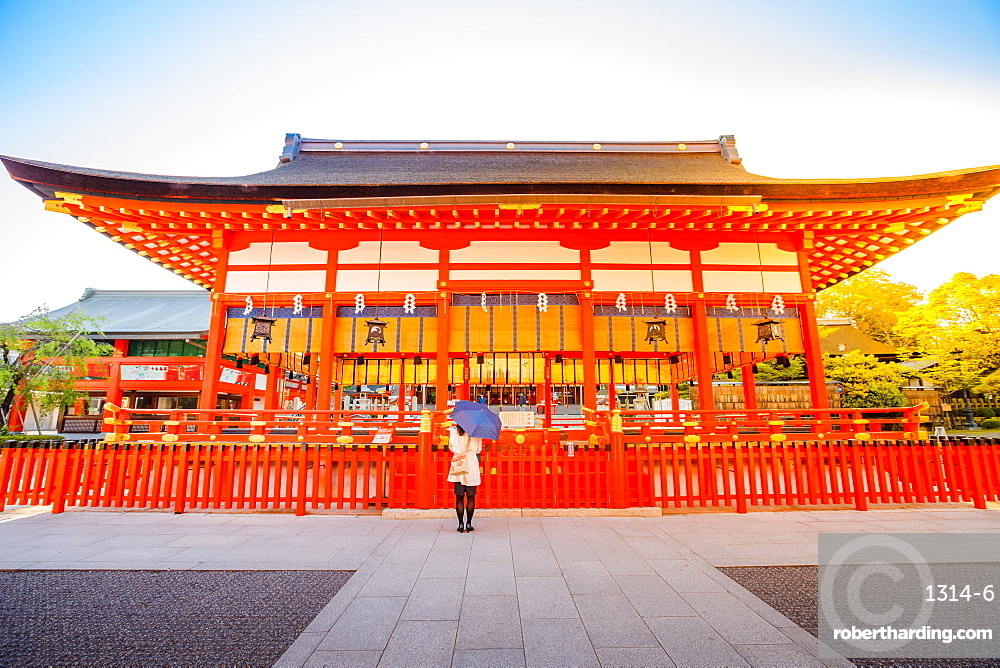 Fushimi Inari taisha. Fushimi Inari is the most important shinto sanctuary and the oldest in Kyoto, Japan. Sunrise light shot.