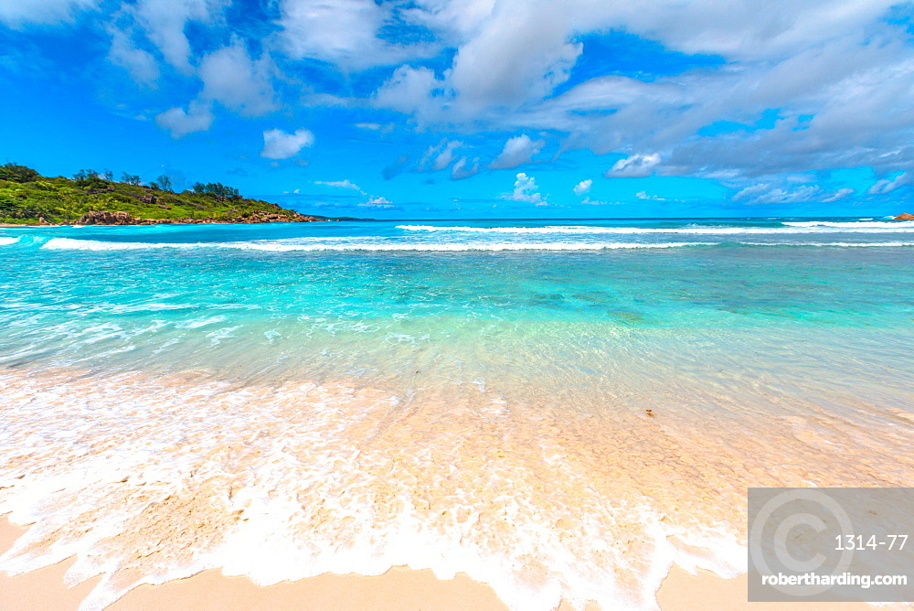 White sandy beach and turquoise clear sea of Anse Cocos, La Digue, Seychelles, Indian Ocean, Africa