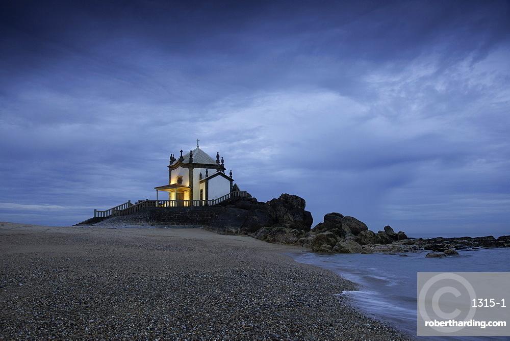 Capela do Senhor da Pedra (Chapel of the Lord of Stone), Miramar, Portugal, at a coastal site originally used for pagan worship.